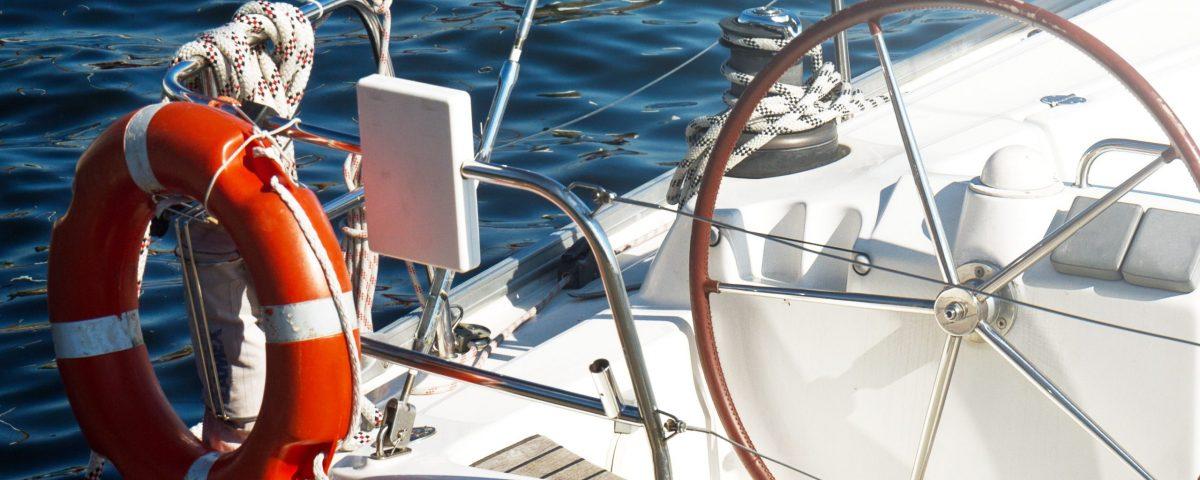 Closeup of Beautiful Yacht Rudder. Daylight. Horizontal. Sea Background.